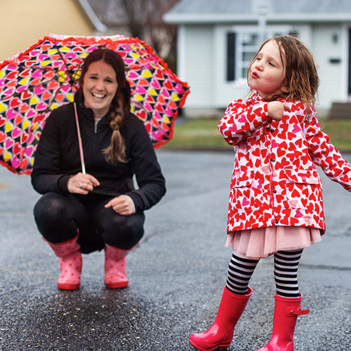Mother and daughter in rain